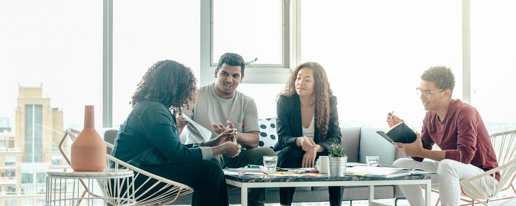Team brainstorm meeting in bright sunny office 1